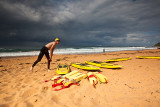 Surf life saver at Newport Beach with approaching storm