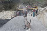 women grinding rocks