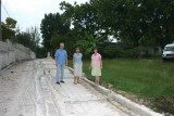 Dr Warrick, Rachel, Martha standing where the wall is now on the road