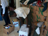 the boxes contained canned foods, cereal, powder milk, toilet paper, bars of soap, shampoo, cereal bars, bags of rice