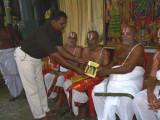 12-Sri Pacchadi Parthasarathi Iyengar swamy receiving the first Book from Sri Jeyaramann swamy.JPG