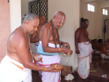 04-Archakas from Melkote taking care of samprokshanam procedures.JPG