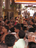 15-Parthasarathy Utsavam.Day 09.Mattai Adi Utsavam.Battar on behalf of Namazhwar pacifying the divine couple.jpg