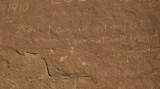 Melancholy note on sandstone wall in Chaco Canyon