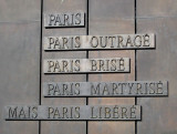 Plaque at the base of the CDG statue