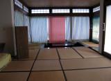 Sunken dining table at far end; tatami mats