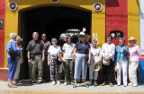 Group picture at the street entrance to the home