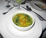 Soup with zucchini flowers