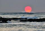 waves under setting sun