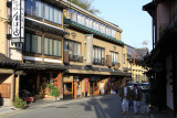 Bathers strolling past the ryokan and shops
