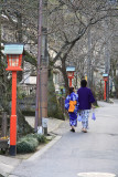 Young couple walking down a quiet backstreet