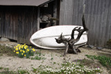 Rowboat and lumber shed outside a house
