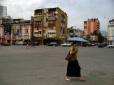 Woman with parasol in central Tirana
