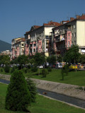 Towering apartment blocks along the Lana River