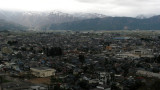 Sprawl of Ōno city and snowcapped mountains