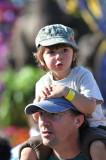Watching Rose Parade float on Dad's shoulder