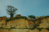 Houses and baobab on the cliff next to ocean drive