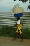 Walking home, load on head, load on back -- Angolan women