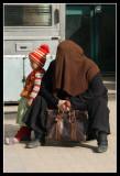 Woman wearing burka and children