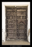 Old wooden door with handmade ornments