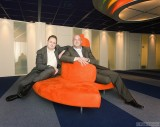 Two managers from a Dutch telecommunications company