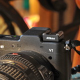 Nikon 1 V1 mit AS N1000 Mikrofonadapter