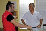 Vaggelis Vlachos explains to the ambassador