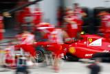 Ferrari's crew practices pit-stop