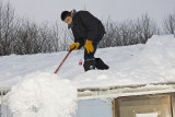 Snow shovelling - Anthony Isaac on the roof