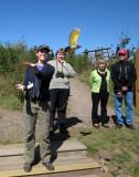 Songbird-bander Kaitlin, releasing a Northern Flicker
