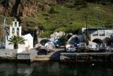 Mini church and boats at Santorini Harbor