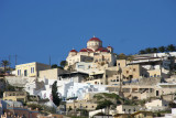 The Village of Pyrgos with spectacular Greek Orthodox Church looming large on the horizon.