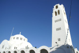 The ornate bell tower and the majestic Metropole Greek Orthodox Church in Fira.