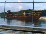 A rusted ship by the docking area