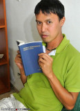 Cesar reading the Bible at Hostal My Home Panama