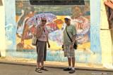 Jean and Dan in front of a mural honoring Paul Gauguin