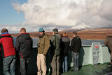 Braving the wind on the front deck of the ferry in the Sound of islay with the snow covered hills of Jura behind