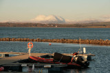 Sunset at Bowmore harbour with the Paps of Jura in the distance