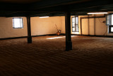 Inside the Bowmore Distillery - the malting hall where the barley is spread on the floor and allowed to germinate