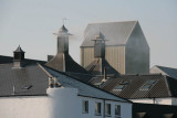 Smoke issues from the distillery turrets as the malted barley is gets its distinctive peat smoked flavour
