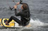 Adam kitesurfing n some windsurfers
