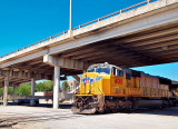 Union Pacific Engine 4018 emerges from a Highway Overpass in the Taylor TX rail yard