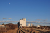 Flagler, CO grain elevators with almost a full moon.