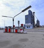 Gothenburg, NE old grain elevators and Texaco pumps.