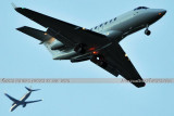 XO Jets Bombardier Challenger 300 CL-30 N541XJ on approach to OPF as AA B737-823 N836NN passes by aviation stock photo