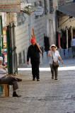 Christian pilgrims in the Via Dolorosa carrying cross
