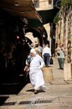 Old woman walking through Muslim Quarter