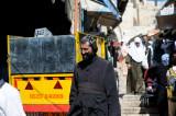 Coptic monk crossing the Muslim quarter