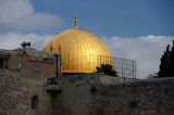 Sunlight hits Dome of the Rock over Western Wall