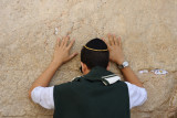 Jewish boy praying at Western Wall